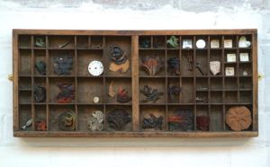 Evocation of a vanished time. Pate-de-verre, ceramic and found objects set in antique font drawer. Price: £475.00